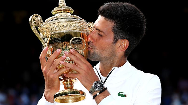 Novak Djokovic, pictured here after winning Wimbledon in 2019.