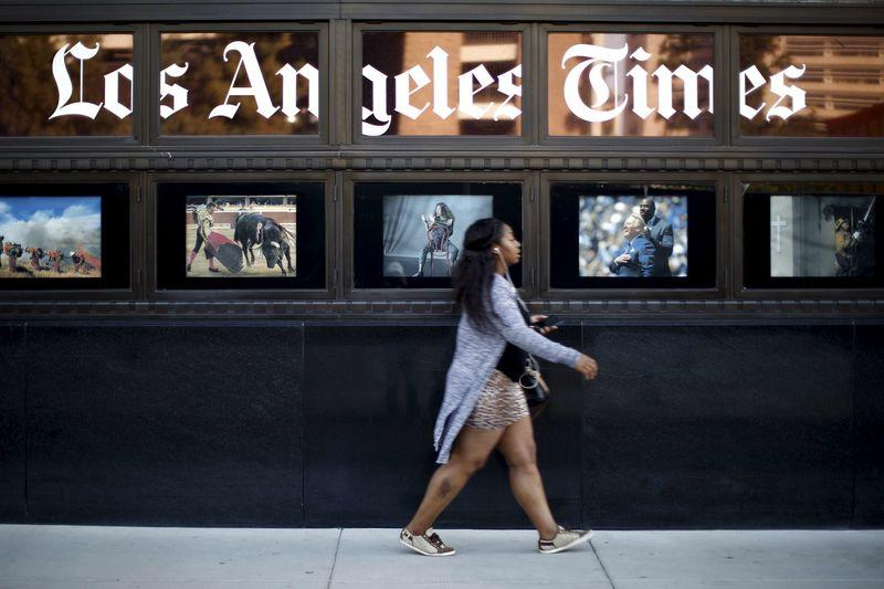 A woman walks past the building of Los Angeles Times newspaper, which is owned by Tribune Publishing Co, in Los Angeles