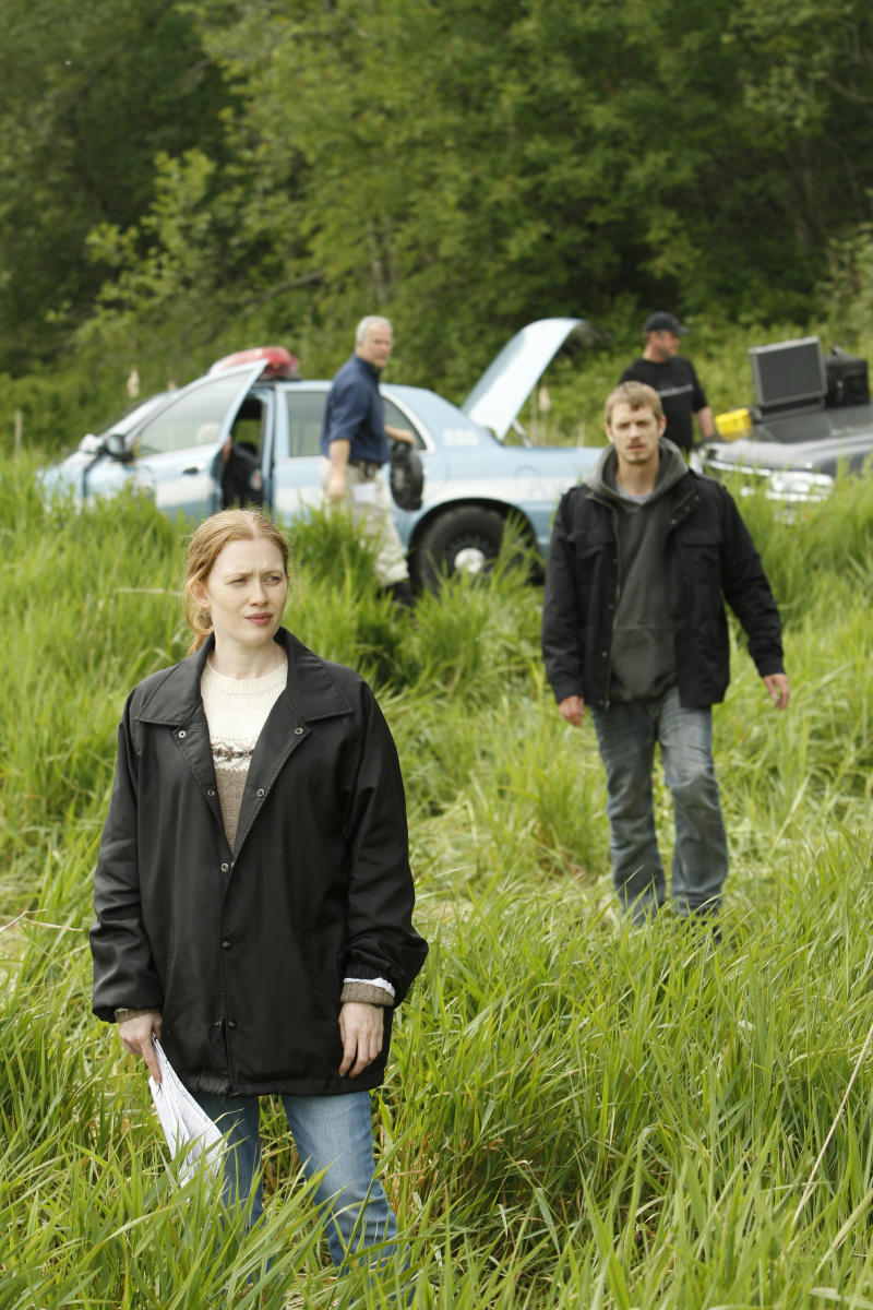 """In this publicity image released by AMC, Mireille Enos portrays Detective Sarah Linden and Joel Kinnaman portrays Detective Stephen Holder, right, in a scene from the AMC original series """"The Killing,"""" premiering April 3, 2011 at 9 p.m. EST. (AP Photo/AMC, Chris Large)"""