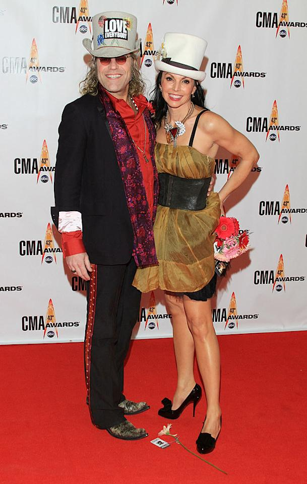 """Kenny Alphin and Christiev Carothers  Grade: D-  Big & Rich's big guy and his wacky wife gave the Judds a run for their money in equally awful ensembles. Taylor Hill/<a href=""""http://www.wireimage.com"""" target=""""new"""">WireImage.com</a> - November 11, 2009"""