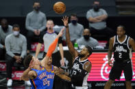Los Angeles Clippers guard Paul George (13) takes a shot against Oklahoma City Thunder forward Isaiah Roby (22) during the second quarter of an NBA basketball game Sunday, Jan. 24, 2021, in Los Angeles. (AP Photo/Ashley Landis)