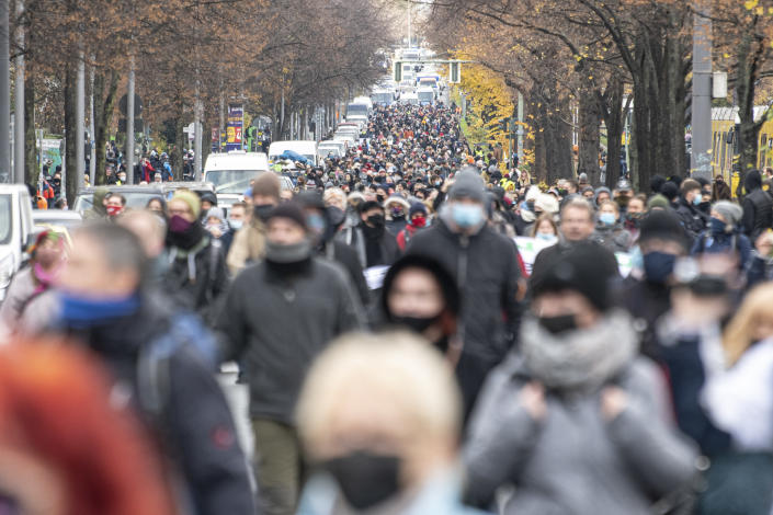 Protestors attend a so called 'silent march' against the corona policy of the federal government at the district Prenzlauer Berg in Berlin Germany, Sunday, Nov. 22, 2020. (Fabian Sommer/dpa via AP)
