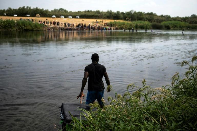 Many of the Haitians at the border were previously living in Chile or Brazil and have traveled overland from South America (AFP/PEDRO PARDO)