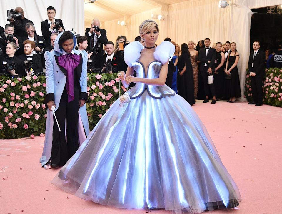 """<p>The <em>Euphoria </em>star took her tribute to Cinderella quite literally, arriving at the 2019 Met Gala in a Tommy Hilfiger gown with her """"fairy godmother"""" (aka stylist) Law Roach in tow. </p>"""