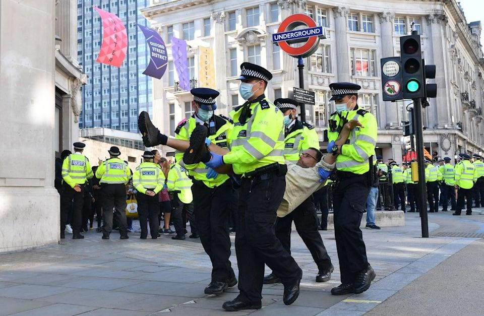 Dozens were taken away by police (AFP via Getty Images)