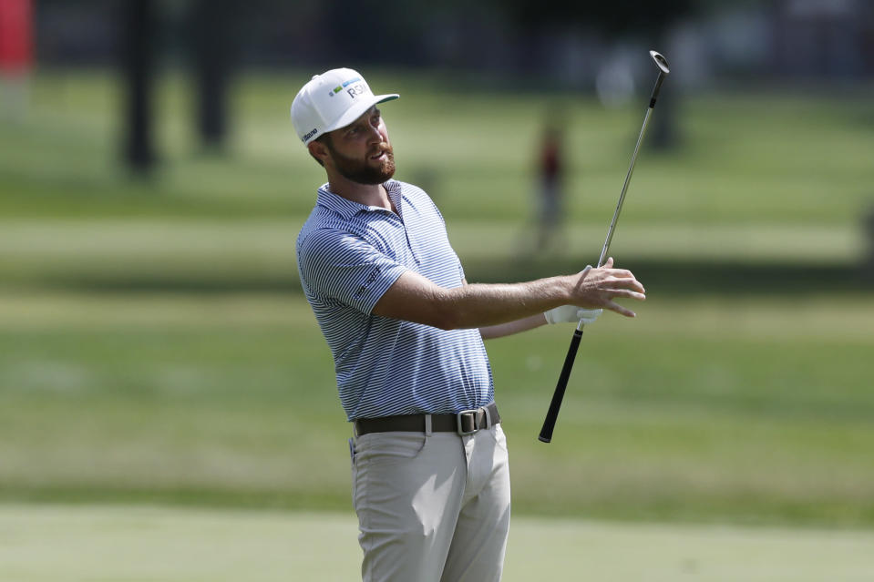Chris Kirk watches his approach shot on the 14th fairway during the second round of the Rocket Mortgage Classic golf tournament, Friday, July 3, 2020, at the Detroit Golf Club in Detroit. (AP Photo/Carlos Osorio)
