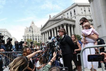 Allred, who is representing alleged victims, speaks to the media with Davies, an alleged victim of Epstein, and an unidentified woman and baby after a hearing in New York