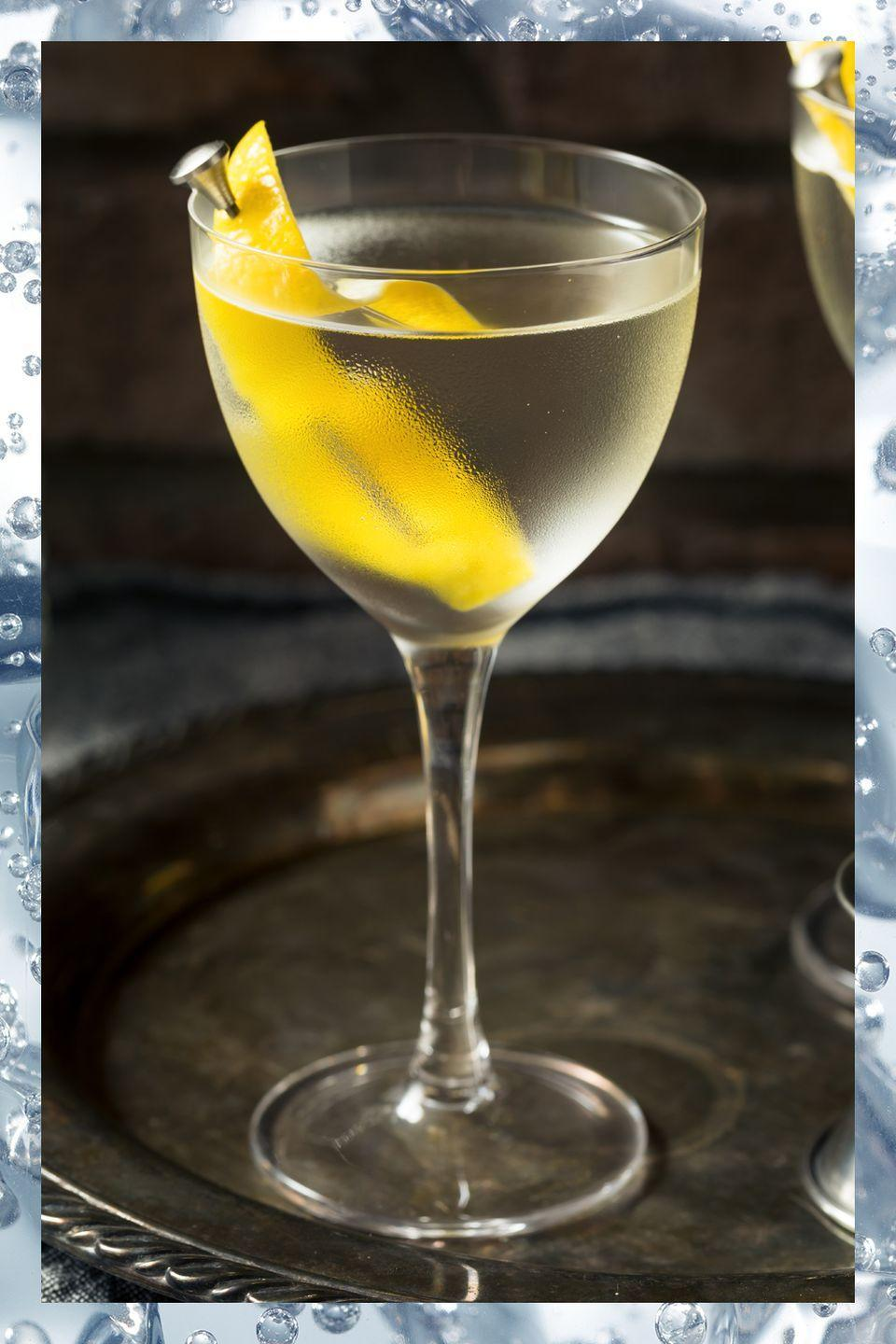 """<p>You might think of a martini when you think of James Bond, but this drink is the true tipple of the iconic spy—the recipe first appeared in Ian Fleming's 1953 novel Casino Royale in homage to the Bond girl Vesper Lynd. While Bond takes his """"shaken, not stirred"""", most stick to the rule that spirits-only cocktails should be stirred instead. </p><p>- 3 oz gin<br>- 1 oz vodka<br>- .5 oz Lillet blanc<br></p><p><em>Combine all ingredients in a mixing glass with ice and stir until well chilled. Garnish with a lemon twist. </em></p>"""