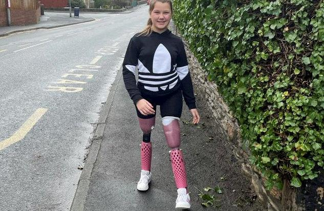 """Maisie Catt. See SWNS story SWNNjab. An 11-year-old double leg amputee is paying tribute to her """"real-life hero"""" Cpt Sir Tom Moore by walking an entire marathon in her garden in his memory. Last year Maisie Catt, who lost her legs to meningitis and septicemia, followed in the veteran's heroic footsteps by walking 26 miles in her garden over the course of ten days. The schoolgirl will now do it all over again in tribute to national hero Cpt Sir Tom, who died from coronavirus on Tuesday after raising more than £30million for NHS charities. Masie is to walk a second marathon to raise money for charity YoungMinds to coincide with Children's Mental Health Week which runs between February 1 and 7."""