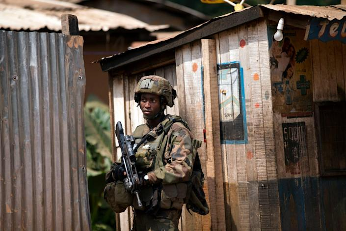 A French soldier stands guard during an operation to secure an area of the Miskine neighborhood, in Bangui, Central African Republic, Thursday, Dec. 26, 2013. The spokesman for an African Union peacekeeping force says six Chadian peacekeepers were killed and 15 were wounded, after being attacked Wednesday.(AP Photo/Rebecca Blackwell)