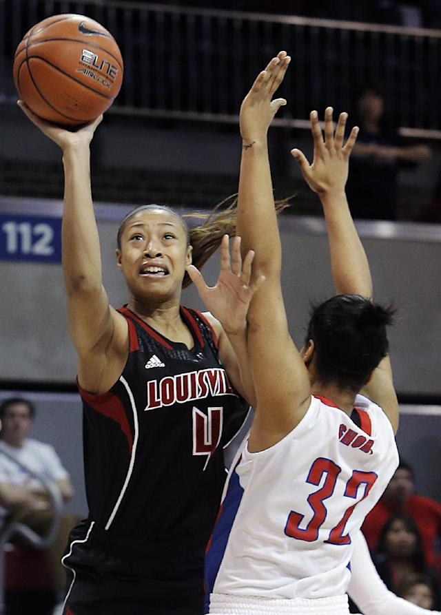 Louisville guard Antonita Slaughter (4) attempts a shot as SMU Raven Short (32) defends in the first half of an NCAA women's college basketball game, Sunday, Jan. 19, 2014, in Dallas. Louisville won 81-66. (AP Photo/Brandon Wade)