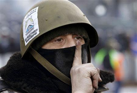 An anti-government protester gestures at the site of clashes with riot police in Kiev, January 27, 2014. REUTERS/Vasily Fedosenko