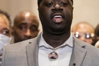 Brandon Williams, nephew of George Floyd, wears a pendant bearing the likeness of his uncle during a news conference after former Minneapolis police Officer Derek Chauvin is convicted in the killing of George Floyd, Tuesday, April 20, 2021, in Minneapolis. (AP Photo/John Minchillo)