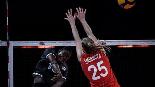 Canada opposite hitter Shainah Joseph, left, spikes the ball against Russia's Kseniia Smirnova during Volleyball Nations League play on Sunday in Rimini, Italy. Russia won 3-0 in sets, handing the Canadian women their eighth loss in 11 matches. (Submitted by Volleyball World - image credit)
