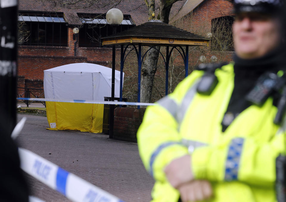 Police officer secures the area as a police tent covers the the spot in Salisbury where former Russian spy double agent Sergei Skripal and his daughter were found critically ill (AP Photo/Frank Augstein)