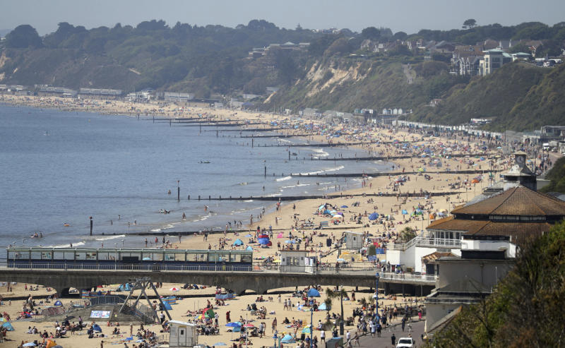 A view of Bournemouth beach on a sunny day, in Bournemouth, England, Wednesday May 20, 2020. Lockdown restrictions due to the coronavirus outbreak have been relaxed allowing unlimited outdoor exercise and activities such as sunbathing. (Andrew Matthews/PA  via AP)