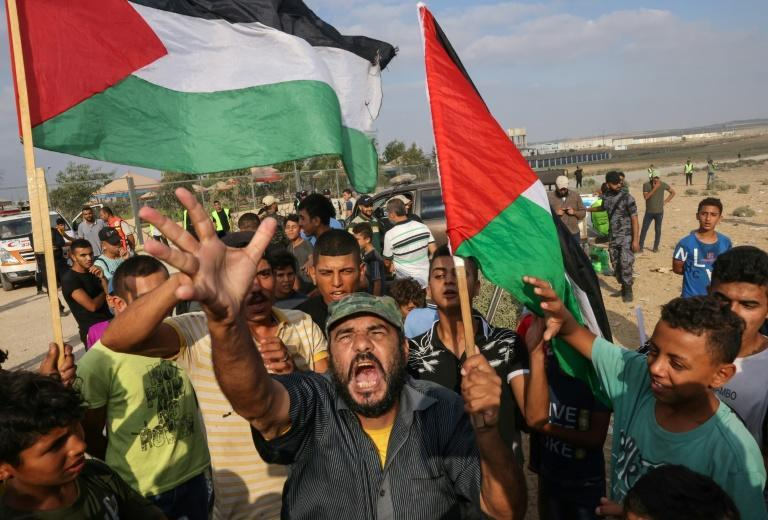 Palestinians protest near the border fence with Israel, east of Gaza City, to denounce the Israeli siege of the Palestinian enclave and express support for Jerusalem's Al-Aqsa mosque, on August 21, 2021