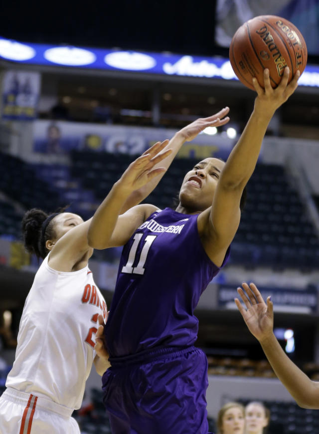 Northwestern forward Lauren Douglas, right, shoots over Ohio State forward Martina Ellerbe in the second half of an NCAA college basketball game in the opening round of the Big Ten Tournament in Indianapolis, Ind., Thursday, March 6, 2014. Ohio State defeated Northwestern 86-77. (AP Photo/Michael Conroy)