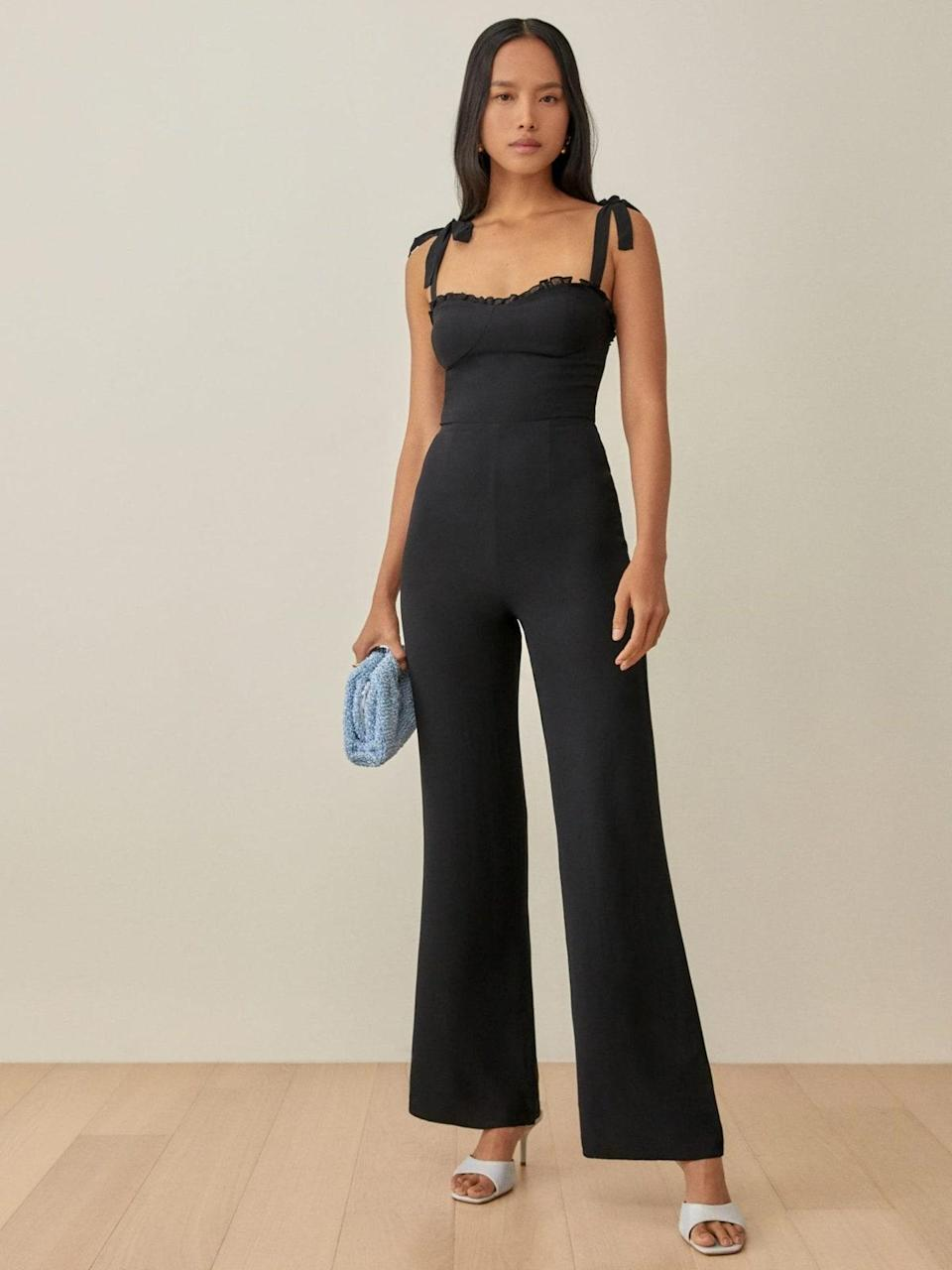 """A wide-leg jumpsuit is definitely a bold choice amid a sea of long wrap dresses and stately ball gowns, though this Reformation number is one we can all get behind. $248, Reformation. <a href=""""https://www.thereformation.com/products/alfred-jumpsuit?color=Black"""" rel=""""nofollow noopener"""" target=""""_blank"""" data-ylk=""""slk:Get it now!"""" class=""""link rapid-noclick-resp"""">Get it now!</a>"""