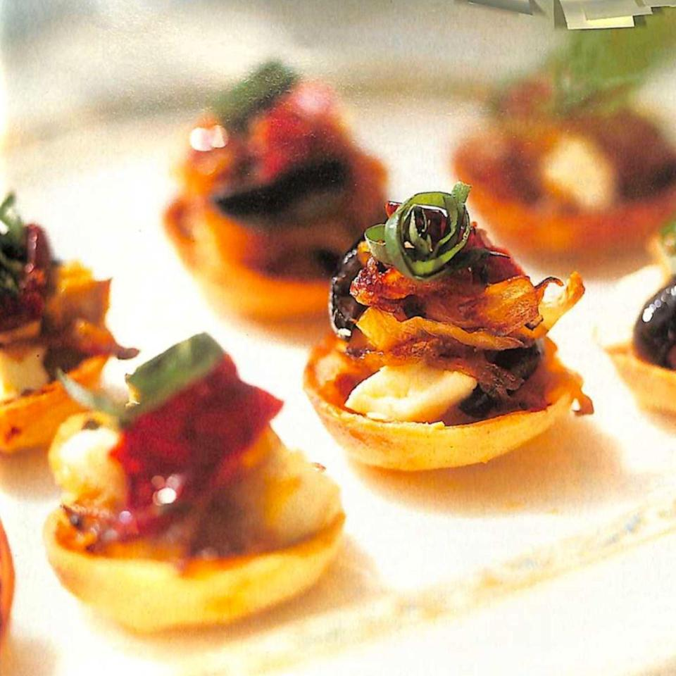 """<p>These popular feta tartlets are deliciously crisp and cheesy.</p><p><strong>Recipe: <a href=""""https://www.goodhousekeeping.com/uk/food/recipes/a544512/caramelised-onion-and-feta-tartlets/"""" rel=""""nofollow noopener"""" target=""""_blank"""" data-ylk=""""slk:Caramelised onion and feta tartlets"""" class=""""link rapid-noclick-resp"""">Caramelised onion and feta tartlets</a></strong></p>"""