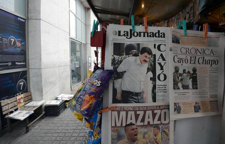 "Mexican newspapers in Mexico City, on February 23, 2014 report the arrest of Mexican drug trafficker Joaquin Guzman Loera aka ""el Chapo Guzman."""