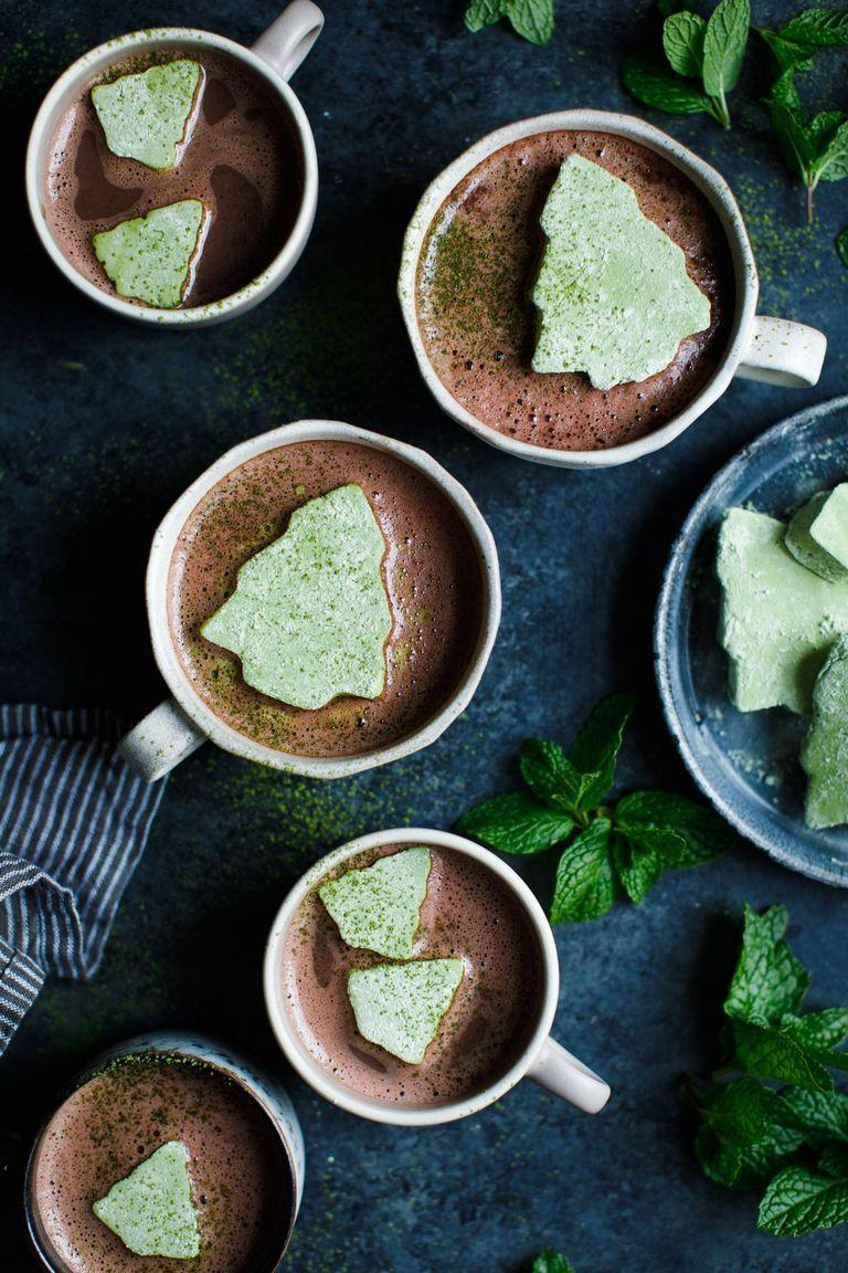"""<p>When you get that white Christmas you've been dreaming about, a piping hot mug of peppermint Schnapps-spiked hot cocoa will warm you from the inside out. </p><p><em>Get the recipe at <a href=""""https://www.snixykitchen.com/matcha-marshmallows-with-fresh-mint-hot-cocoa/"""" rel=""""nofollow noopener"""" target=""""_blank"""" data-ylk=""""slk:Snixy Kitchen"""" class=""""link rapid-noclick-resp"""">Snixy Kitchen</a>. </em></p>"""