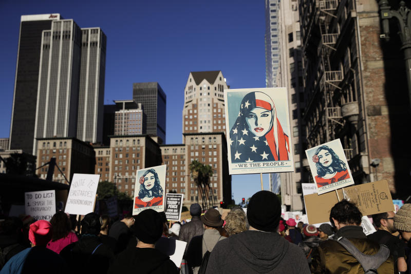 FILE - In this Jan. 20, 2018, file photo, people gather for a Women's March in Los Angeles. Three years after Trump took office and millions of people swarmed to the Women's March in Washington and companion marches across the country, these typically modest protests are often the most visible sign of today's Trump resistance. (AP Photo/Jae C. Hong, File)