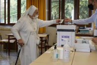 A nun casts her ballot for the abortion referendum at a polling station in San Marino, Sunday, Sept. 26, 2021. Tiny San Marino is one of the last countries in Europe which forbids abortion in any circumstance — a ban that dates from 1865. Its citizens are voting Sunday in a referendum calling for abortion to be made legal in the first 12 weeks of pregnancy. (AP Photo/Antonio Calanni)