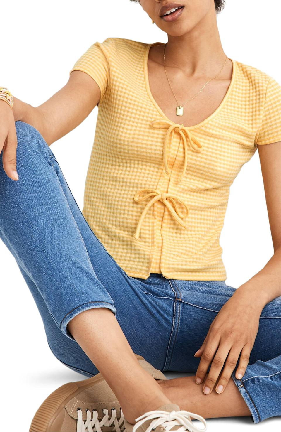 <p>You could easily wear this <span>Madewell Gingham Bow Front Top</span> ($50) all month.</p>