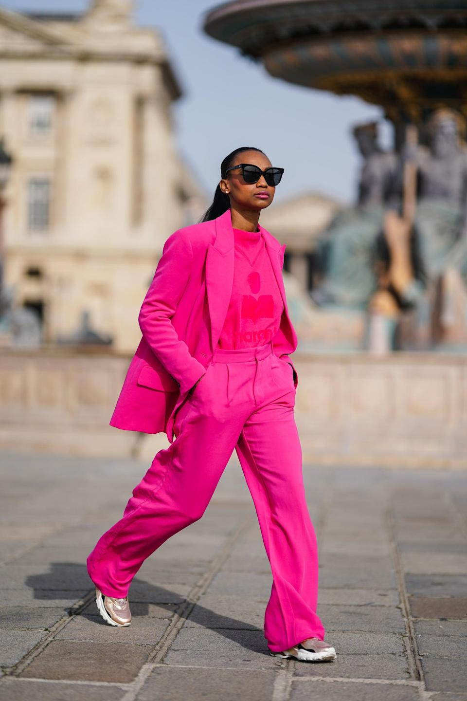 <p>A matching set makes such a statement, especially in a bright color. Pro tip: pair your suit with sneakers instead of heels for a more casual look.</p>