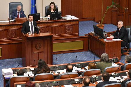Macedonian Prime Minister Zoran Zaev addresses the deputies of the parliament during a vote  to pass constitutional changes in Skopje