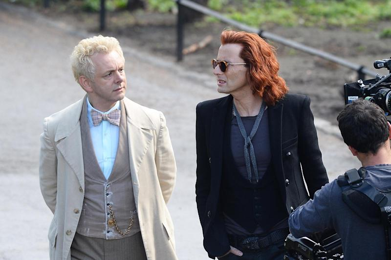 Attacked: David Tennant (left) with Michael Sheen on the set of Good Omens: PA