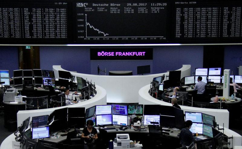 Traders work in front of the German share price index, DAX board, at the stock exchange in Frankfurt, Germany, August 29, 2017. REUTERS/Staff/Remote