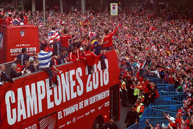 Soccer Football - Atletico Madrid Celebrate Winning The Europa League - Neptuno Square, Madrid, Spain - May 18, 2018 Atletico Madrid players on an open top bus in front of the fans during the celebrations REUTERS/Juan Medina