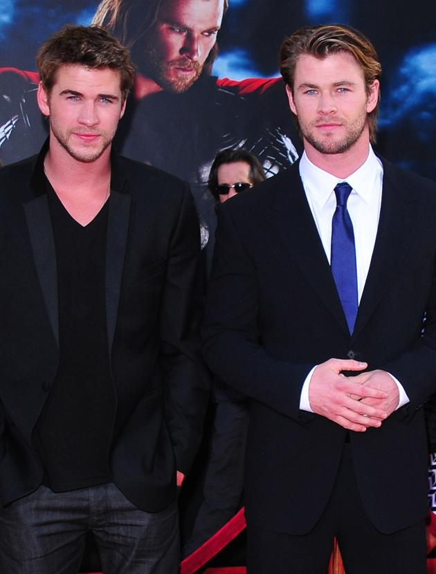 Chris Hemsworth and Liam Hemsworth photos: The brothers do their 'serious' face and look sexy while they're at it. Copyright [Getty]