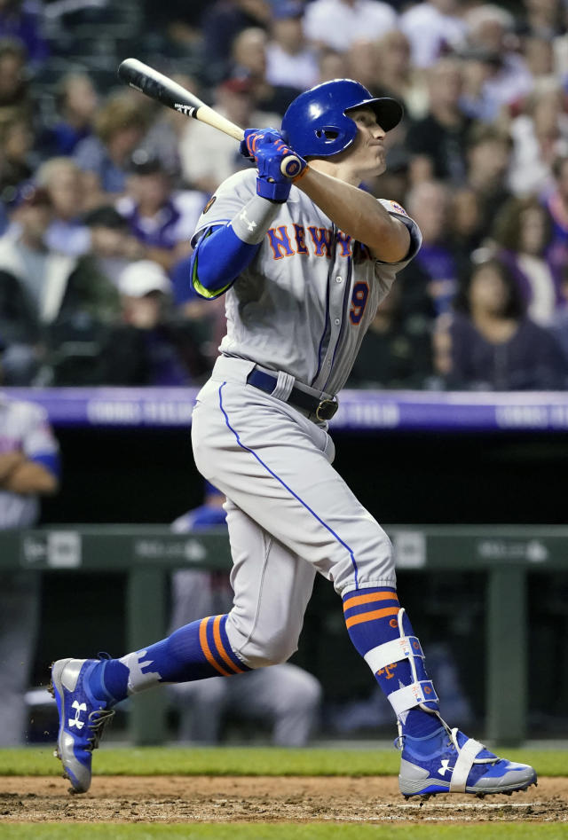 New York Mets' Brandon Nimmo watches the flight of a home run ball hit off Colorado Rockies relief pitcher Harrison Musgrave during the seventh inning of a baseball game, Monday, June 18, 2018, in Denver. (AP Photo/Jack Dempsey)