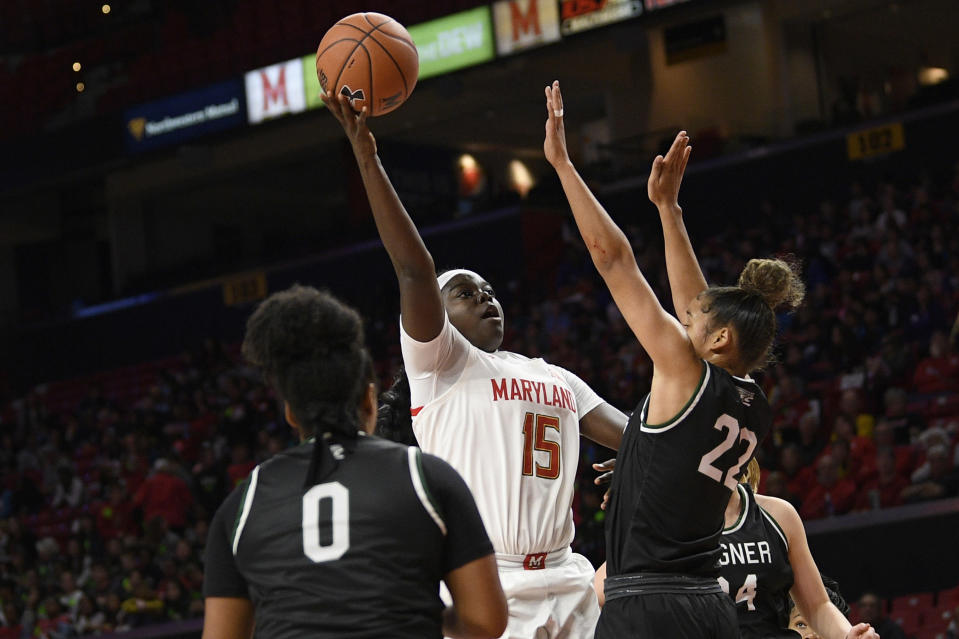 Maryland guard Ashley Owusu (15) goes to the basket as Wagner forward Khaleah Edwards (22) and guard Alex Cowan (0) defend during the first half of an NCAA college basketball game, Tuesday, Nov. 5, 2019, in College Park, Md. (AP Photo/Nick Wass)