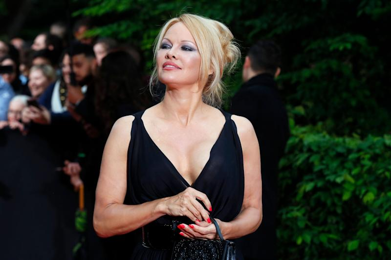 US actress Pamela Anderson arrives with Soccer player Adil Rami at the UNFP (Union of French Professional Footballers) ceremony, in Paris, France, Sunday, May 19, 2019. (AP Photo/Francois Mori) (Photo: ASSOCIATED PRESS)