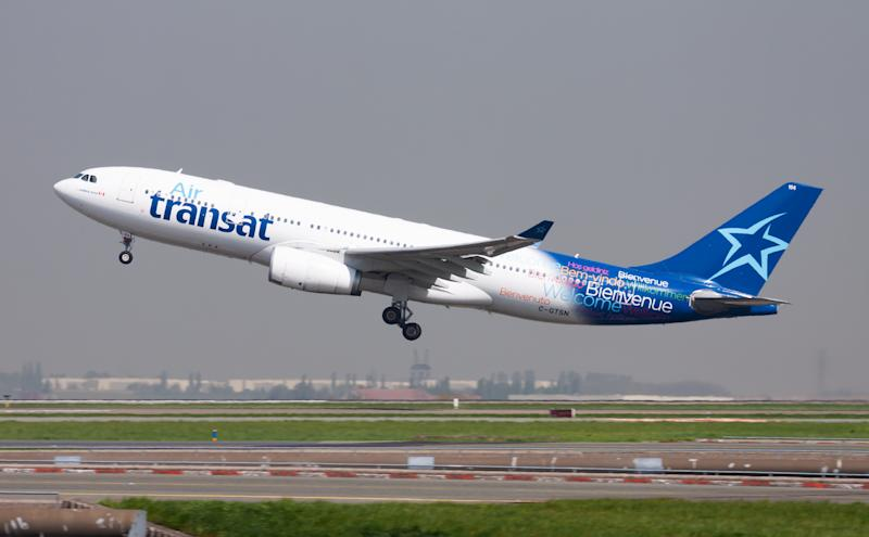 Paris / France - April 24, 2015: Air Transat Airbus A330-200 C-GTSN passenger plane departure and take off at Paris Charles de Gaulle Airport