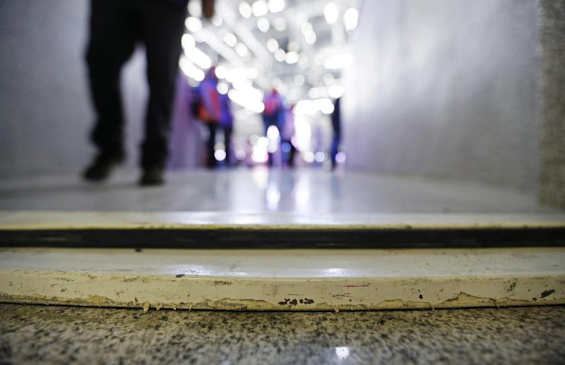 A door frame raised from the floor lies across an entrance to wheelchair seating at the Bolshoy Ice Dome at the 2014 Winter Olympics, Tuesday, Feb. 18, 2014, in Sochi, Russia. Olympic organizers have repeatedly touted accessibility for people with disabilities as one of the chief lasting benefits of hosting the Winter Games in Sochi. But with less than three weeks until the Paralympics, infrastructure around Olympic Park and its venues are not entirely barrier-free. (AP Photo/David Goldman)
