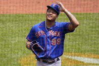 New York Mets starting pitcher Taijuan Walker walks to the dugout after being taken out in the bottom of the first inning after giving up six runs during a baseball game against the Pittsburgh Pirates in Pittsburgh, Sunday, July 18, 2021. (AP Photo/Gene J. Puskar)