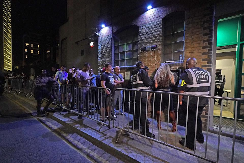 People queue up for the Egg nightclub in London, after the final legal coronavirus restrictions were lifted in England (Jonathan Brady/PA) (PA Wire)