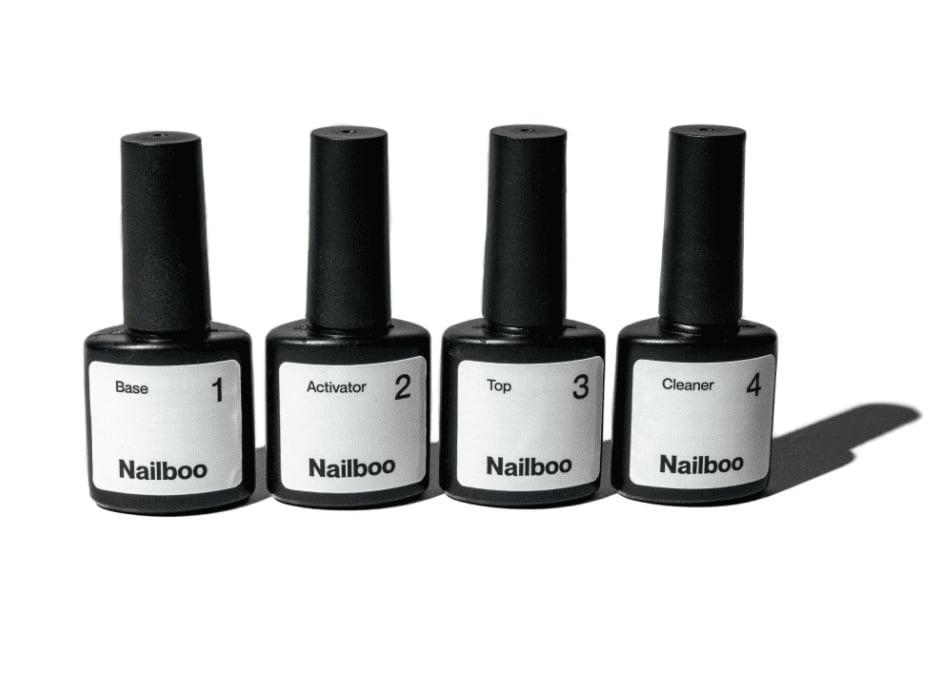 """<ul> <li><strong>Instructional Videos Helped the Process:</strong> All of Nailboo's kits come with the basics. There are four liquids - base, activator, top, and brush cleaner - and a """"build powder."""" If you've only ever painted your nails with regular lacquer, it might look intimidating. Nailboo anticipated this and has several <a href=""""https://nailboo.com/pages/tutorials"""" class=""""link rapid-noclick-resp"""" rel=""""nofollow noopener"""" target=""""_blank"""" data-ylk=""""slk:incredibly helpful tutorials"""">incredibly helpful tutorials</a> on its website. (I found """"<a href=""""https://www.youtube.com/watch?v=TcBPcKj8yvE"""" class=""""link rapid-noclick-resp"""" rel=""""nofollow noopener"""" target=""""_blank"""" data-ylk=""""slk:Get to Know Your Kit"""">Get to Know Your Kit</a>"""" to be the most informative overall.)</li> <li><strong>Nailboo Has a Great Color Selection:</strong> <a href=""""https://nailboo.com/collections/powder"""" class=""""link rapid-noclick-resp"""" rel=""""nofollow noopener"""" target=""""_blank"""" data-ylk=""""slk:Nailboo currently has 58 colors"""">Nailboo currently has 58 colors</a> to choose from. I tried a selection called <a href=""""https://nailboo.com/collections/powder/products/copy-of-diamond-daze"""" class=""""link rapid-noclick-resp"""" rel=""""nofollow noopener"""" target=""""_blank"""" data-ylk=""""slk:Modern Mint"""">Modern Mint</a>, and was pleasantly surprised that the color was actually more neutral on in-person than it was on the website. You never know with dip! Once you put on that top coat, the color can change entirely.</li> <li><strong>It Was Quick:</strong> Compared to a traditional lacquer manicure, which can take over an hour to dry, or a gel mani, which requires a UV light, dip is a relatively fast routine. You'll need to apply a base and two layers of color, activate, file, and top it off. Wait for that top coat to dry (two minutes max) and you're good to go!</li> <li><strong>The Manicure Lasts:</strong> I kept the dip on for two weeks then opted to remove it. It was every bit as durable as pricier dip systems.</li> </ul>"""