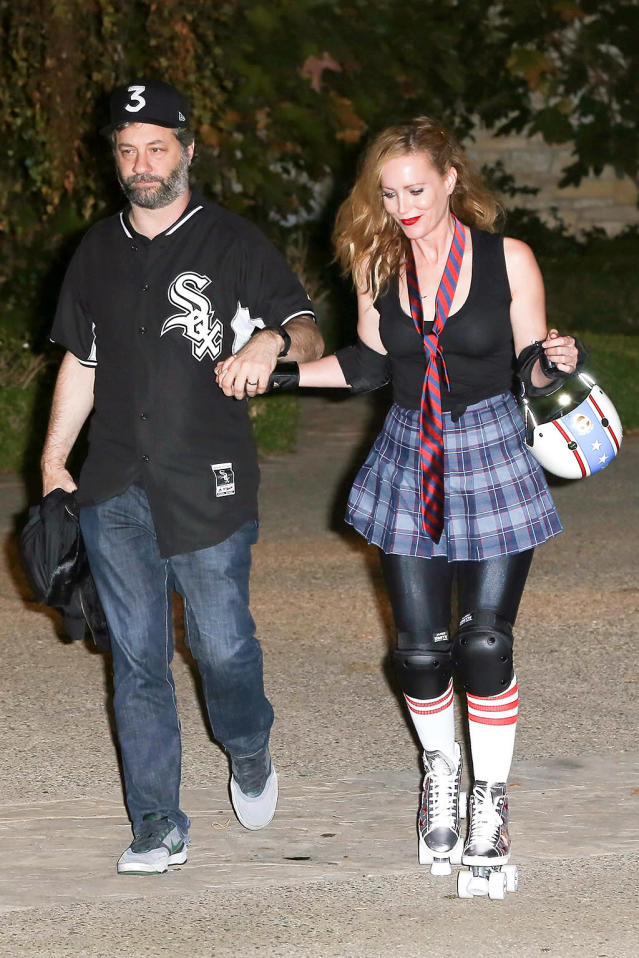<p>The writer/director/produce also was a bit of a Halloween dud in his basic White Sox jersey, but his actress wife made up for it with her fun roller derby girl getup. (Photo: AKM-GSI) </p>