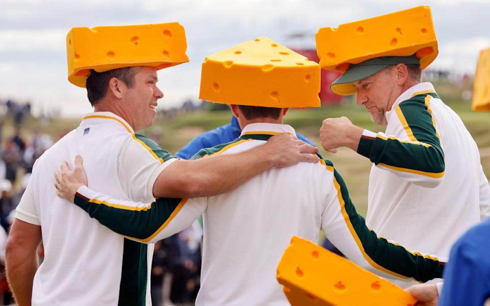 Ian Poulter (right) and Paul Casey (left) embrace the cheese - REUTERS