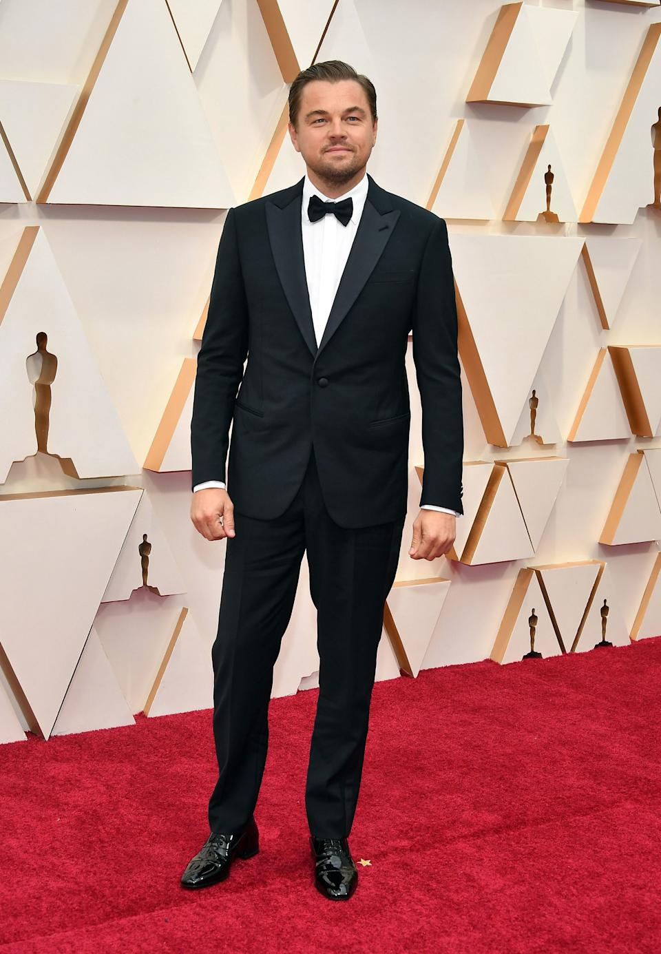 DiCaprio looked polished in a tailored tux as he arrived solo on the Oscars red carpet.