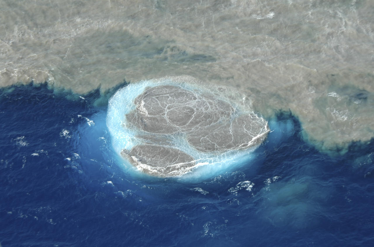 Volcanic activity in the sea off the Canary island of El Hierro  is seen in this areal  photo taken and released by the Canary Islands Government on Saturday  Nov. 5, 2011. The regional government of the Canary Islands on Saturday Nov. 5, 2011has ordered the evacuation of homes and road closures near the southern tip of El Hierro after two earth tremors and increased offshore volcanic activity caused a buildup of malodorous debris floating on the sea.Seismic activity began in the area on July 17 and residents have since been rocked by more than 10,000 tremors, while underwater fissures have released an almost continuous flow of sulfurous gases, smoke and hot objects.El Hierro has some 11,000 residents and was formed by volcanic activity. (AP Photo/Canary Islands Government)  EDITORIAL USE ONLY - NO SALES