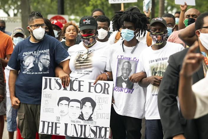 "<span class=""element-image__caption"">On 16 May, Ahmaud Arbery's aunt Theawanza Brooks, center left, joins other family members and supporters in a march from the Glynn county courthouse to a police station.</span> <span class=""element-image__credit"">Photograph: Stephen B Morton/AP</span>"