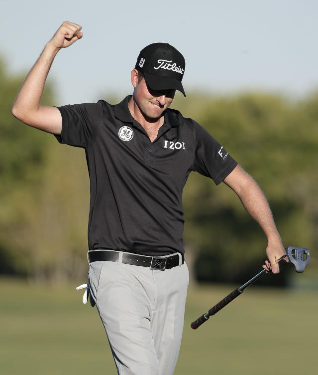 Webb Simpson celebrates after sinking a putt on the 18th green during the final round of the TPC Summerlin tournament, Sunday, Oct. 20, 2013, in Las Vegas. Simpson won the tournament finishing 24-under 260. (AP Photo/Julie Jacobson)