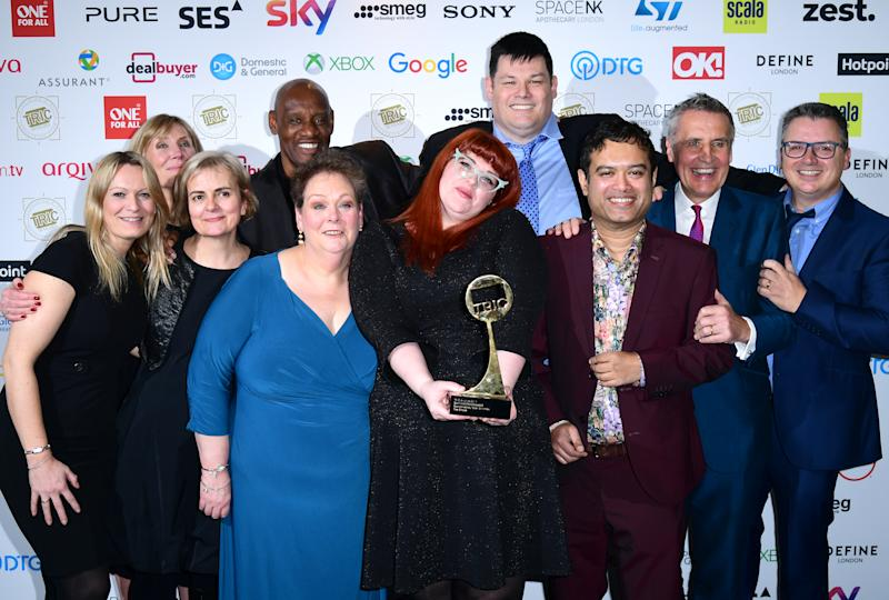 Anne Hegerty, Shaun Wallce, Jenny Ryan, Makr Labbett, and Paul Sinha and the crew of The Chase with the award for Best Daytime Programme at the TRIC Awards 2019 50th Birthday Celebration held at the Grosvenor House Hotel, London. (Photo by Ian West/PA Images via Getty Images)